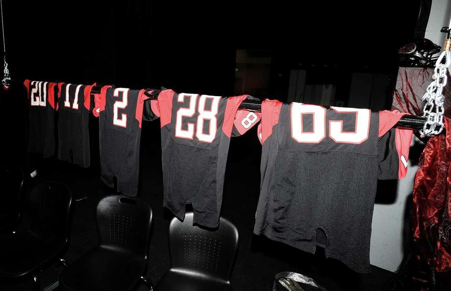 Jerseys hang in preparation of the eleven students that will be signing contracts for Wednesdays Signing Day at Port Arthur Memorial High School on Tuesday, February 5, 2013. Photo taken: Randy Edwards/The Enterprise