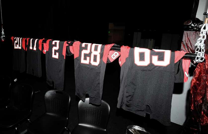Jerseys hang in preparation of the eleven students that will be signing contracts for Wednesdays Sig