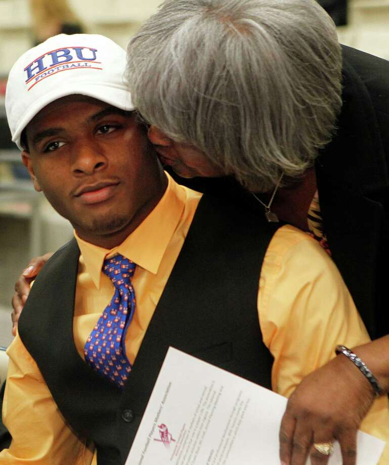 Hightower High School's Terrell Brown, gets a kiss from his grandmother, Sally Tarver, as he made his commitment to play football at Houston Baptist University during a signing day ceremony at the Buddy Hopson Field House Tuesday, Feb. 5, 2013, in Missouri City. Photo: Johnny Hanson, Houston Chronicle / © 2013  Houston Chronicle