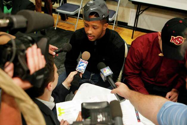 Hightower High School's Maurice Smith talks to the media as he made his commitment to play football at Alabama during a signing day ceremony at the Buddy Hopson Field House Tuesday, Feb. 5, 2013, in Missouri City. Photo: Johnny Hanson, Houston Chronicle / © 2013  Houston Chronicle