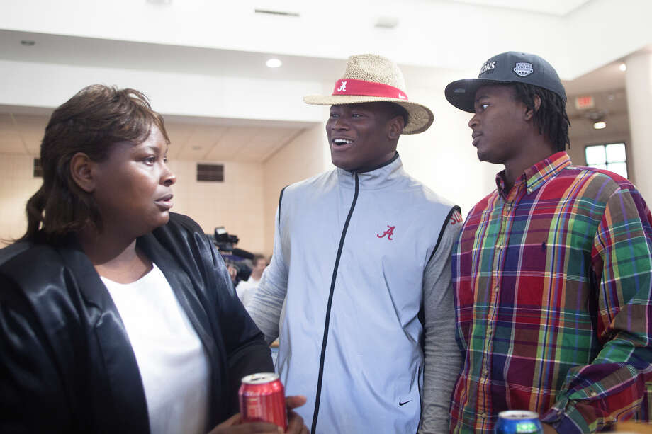 Rueben Foster, center, talks to his brother Danny Foster after announcing his intentions to attend the University of Alabama and play college football during National Signing Day on Wednesday, Feb. 6, 2013, in Auburn, Ala.  (AP Photo/Opelika-Auburn News, Albert Cesare) Photo: Albert Cesare, Associated Press / Opelika-Auburn News
