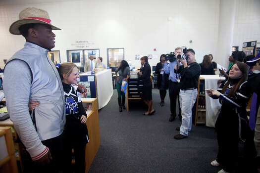 An uburn High School cheerleader takes her photo with Reuben Foster after after announcing his intentions to attend the University of Alabama and play college football during National Signing Day on Wednesday, Feb. 6, 2013, in Auburn, Ala.  (AP Photo/Opelika-Auburn News, Albert Cesare) Photo: Albert Cesare, Associated Press / Opelika-Auburn News