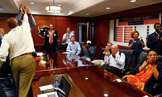The Auburn coaching stafff reacts to watching Montravius Adams announced that was signing with the Tigers to attend Auburn and play NCAA college football on national signing day on Wednesday, Feb 6, 2013 in Auburn, Ala. Auburn coach Gus Malzahn is standing center.(AP Photo/Todd J. Van Emst) Photo: Todd J. Van Emst, Associated Press / FR8775 AP