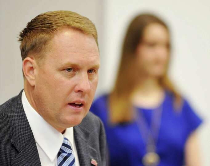 Mississippi football coach Hugh Freeze discusses the school's new signees, during a news conferen
