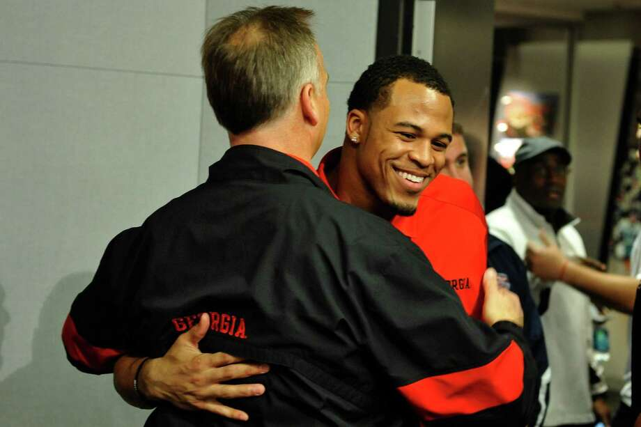 Georgia safety Tray Matthews hugs head coach Mark Richt during a national signing day news conference in Athens, Ga., Wednesday, Feb. 6, 2013. (AP Photo/The Athens Banner-Herald, AJ Reynolds)   MAGS OUT; MANDATORY CREDIT Photo: AJ Reynolds, Associated Press / OnlineAthens & The Athens Banner