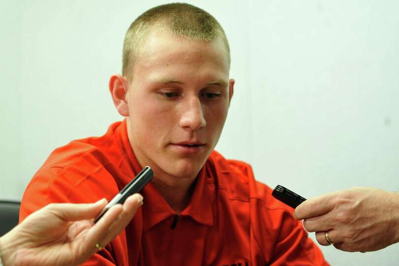 Georiga quarterback early enrollee Brice Ramsey takes questions during a national signing day press