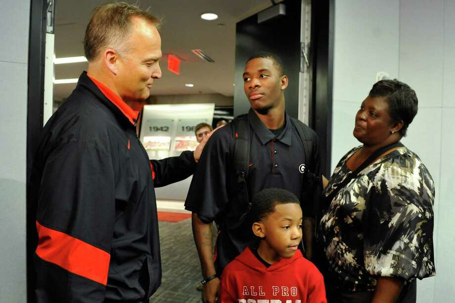 Georgia head coach Mark Richt, left, greets Reggie Wilkerson and family after a national signing day news conference in Athens, Ga., Wednesday, Feb. 6, 2013. (AP Photo/The Athens Banner-Herald, AJ Reynolds)   MAGS OUT; MANDATORY CREDIT Photo: AJ Reynolds, Associated Press / OnlineAthens & The Athens Banner