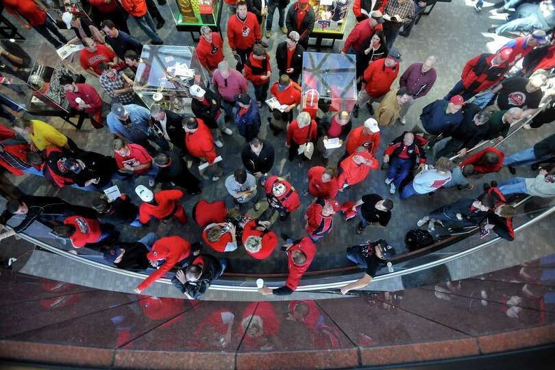 Fans wait for Georgia coaches during a national signing day news conference in Athens, Ga., Wednesda