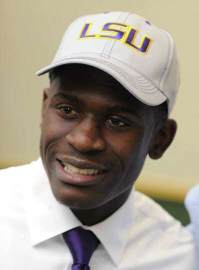Tre'Davious White smiles after he signed a letter of intent to attend LSU and play college football