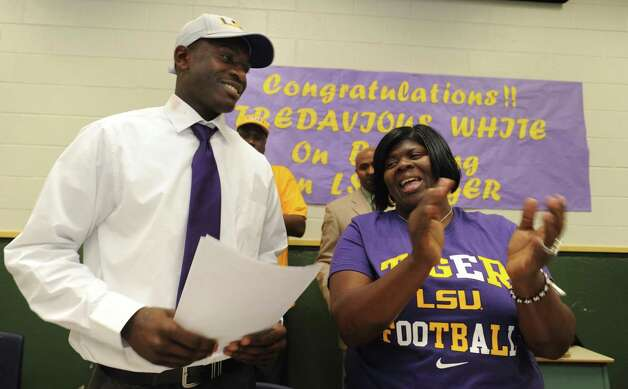 Tre'Davious White and his mother, LaShawnita Ruffins, smile after he signed a letter of intent to attend LSU and play college football during national signing day, Wednesday, Feb. 6, 2013 at Green Oaks High School in School in Shreveport, La. (AP Photo/The Shreveport Times, Jim Hudelson) MAGS OUT; MANDATORY CREDIT SHREVEPORTTIMES.COM Photo: Jim Hudelson, Associated Press / The Shreveport Times