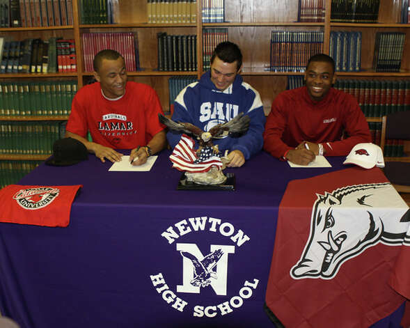 Three Newton football players signed letters of intent on Wednesday, Feb. 6, 2013. From left, defensive end Romando Stewart signed with Lamar, linebacker Corey Jenkins signed with Southern Arkansas and defensive back D.J. Dean signed with Arkansas. Photo: Courtesy Of Sherry Tracy