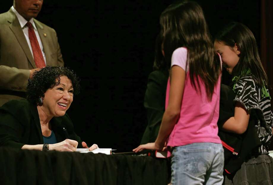 "Sonia Sotomayor signs copies of ""My Beloved World"" at an event in San Francisco. In the memoir, she tells of growing up in near-poverty and becoming a Supreme Court justice. Photo: Justin Sullivan / Getty Images"