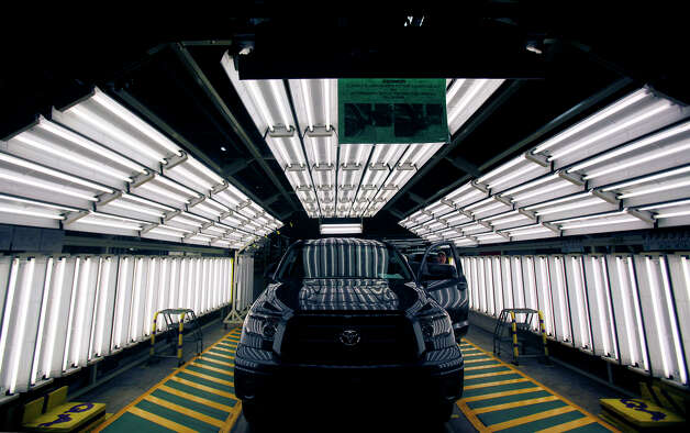 A Toyota Tundra truck is given the once over under an array of fluorescent tubes in the final inspection phase of the assembly line, at Toyota's 2.2 million square-foot plant in San Antonio, Monday, October 19, 2009. Photo: Shaminder Dulai, San Antonio Express-News / sdulai@express-news.net