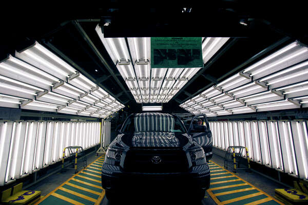 A Toyota Tundra truck is given the once over under an array of fluorescent tubes in the final inspection phase of the assembly line, at Toyota's 2.2 million square-foot plant in San Antonio, Monday, October 19, 2009.