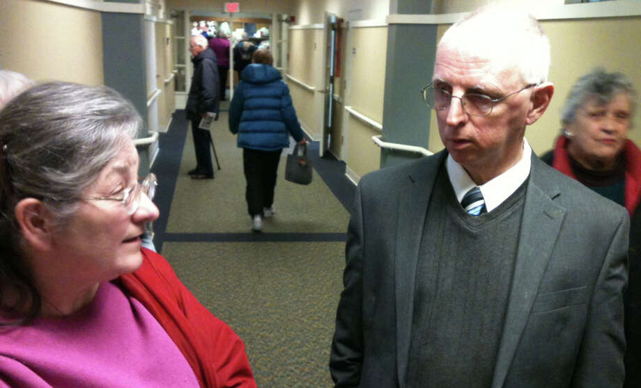 Assessor Don Ross talks with Irene Petitti after a forum on the town's senior tax relief program in the Fairfield Senior Center on Wednesday morning.   FAIRFIELD CITIZEN, CT 2/6/13 Photo: Andrew Brophy / Fairfield Citizen contributed