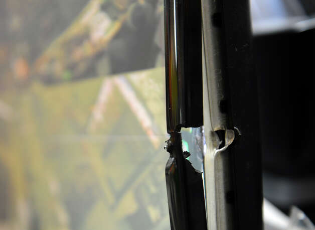 "A bullet left this security monitor damaged at Nick's Grocery store in Bridgeport, Conn. on Wednesday February 3, 2013. Two masked gumen tried to rob owner Osama ""Sammy"" Ghalayini yesterday evening but he used his gun to defend himself. A gun battle ensued leaving many spots in the store riddled with bullet holes. Photo: Christian Abraham / Connecticut Post"