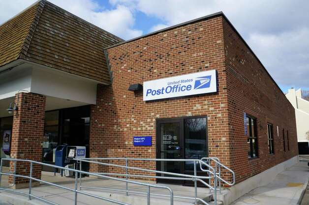 The U.S. Postal Service operates its main Westport branch in the Playhouse Square shopping center on Post Road East. Photo: Paul Schott / Westport News
