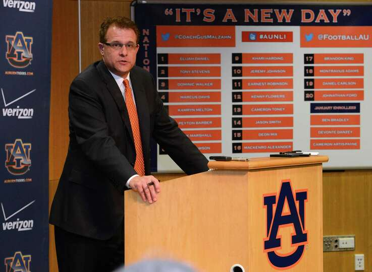 Auburn coach Gus Malzahn talks to the media during NCAA college football national signing day on Wed