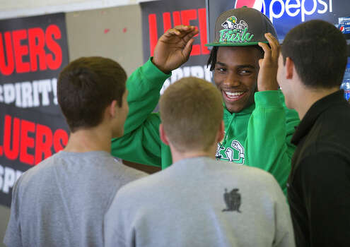 Jaylon Smith, a linebacker from Bishop Luers, talks with friends before signing a letter of intent with Notre Dame on Wednesday, Feb. 6, 2013, in Fort Wayne, Ind. (AP Photo/The Journal-Gazette, Swikar Patel) NEWS-SENTINEL OUT  MAGS OUT  NO SALES Photo: Swikar Patel, Associated Press / The Journal-Gazette