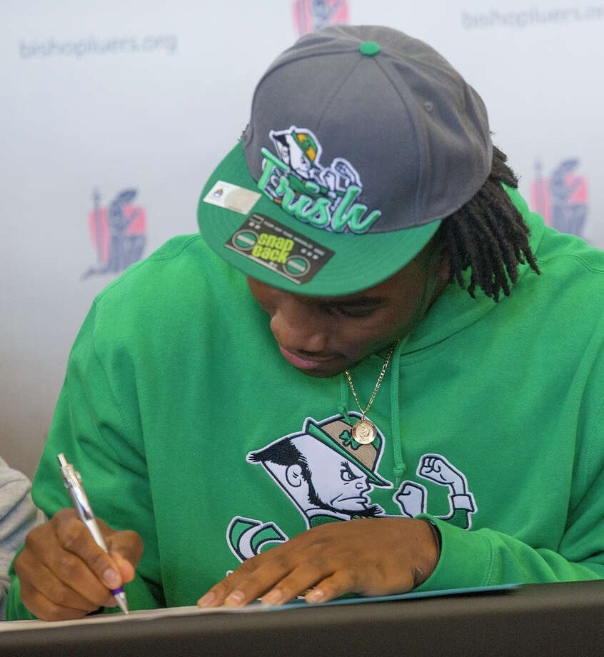Jaylon Smith, a linebacker from Bishop Luers, signs his letter of intent with Notre Dame, at the high school on Wednesday, Feb. 6, 2013, in Fort Wayne, Ind. (AP Photo/The Journal-Gazette, Swikar Patel) NEWS-SENTINEL OUT  MAGS OUT  NO SALES Photo: Swikar Patel, Associated Press / The Journal-Gazette