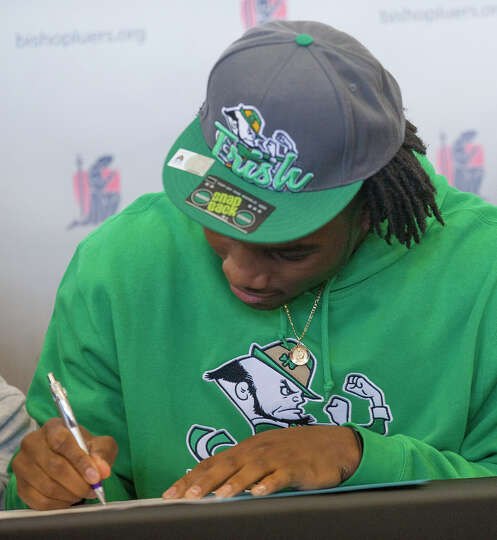 Jaylon Smith, a linebacker from Bishop Luers, signs his letter of intent with Notre Dame, at the hig