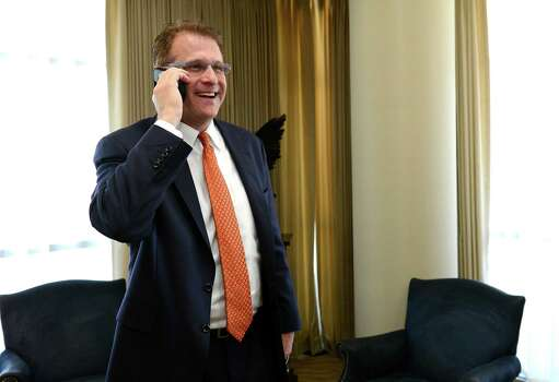 Auburn football coach Gus Malzahn talks to running back Peyton Barber after receiving Barber's paperwork about attending the school and playing football, Wednesday, Feb. 6, 2013, in Auburn, Ala. (AP Photo/Todd J. Van Emst) Photo: Todd J. Van Emst, Associated Press / FR8775 AP