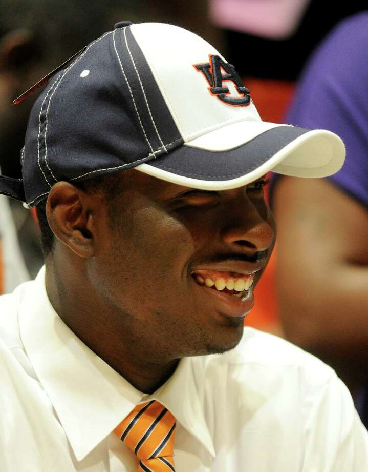 Carver High School quarterback Jeremy Johnson dons an Auburn cap during a national signing day ceremony Wednesday, Feb. 6, 2013, in Montgomery, Ala. Johnson signed to attend Auburn University and play football. (AP Photo/AL.com, Julie Bennett) MAGS OUT Photo: JULIE BENNETT, Associated Press / AL.COM