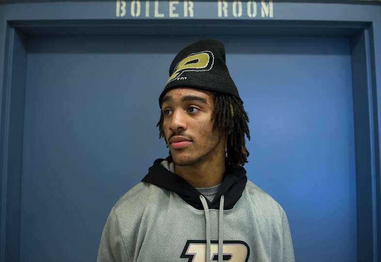 TyVel Jemison, a cornerback, stands for a photo after he signed a letter of intent with Purdue, at B