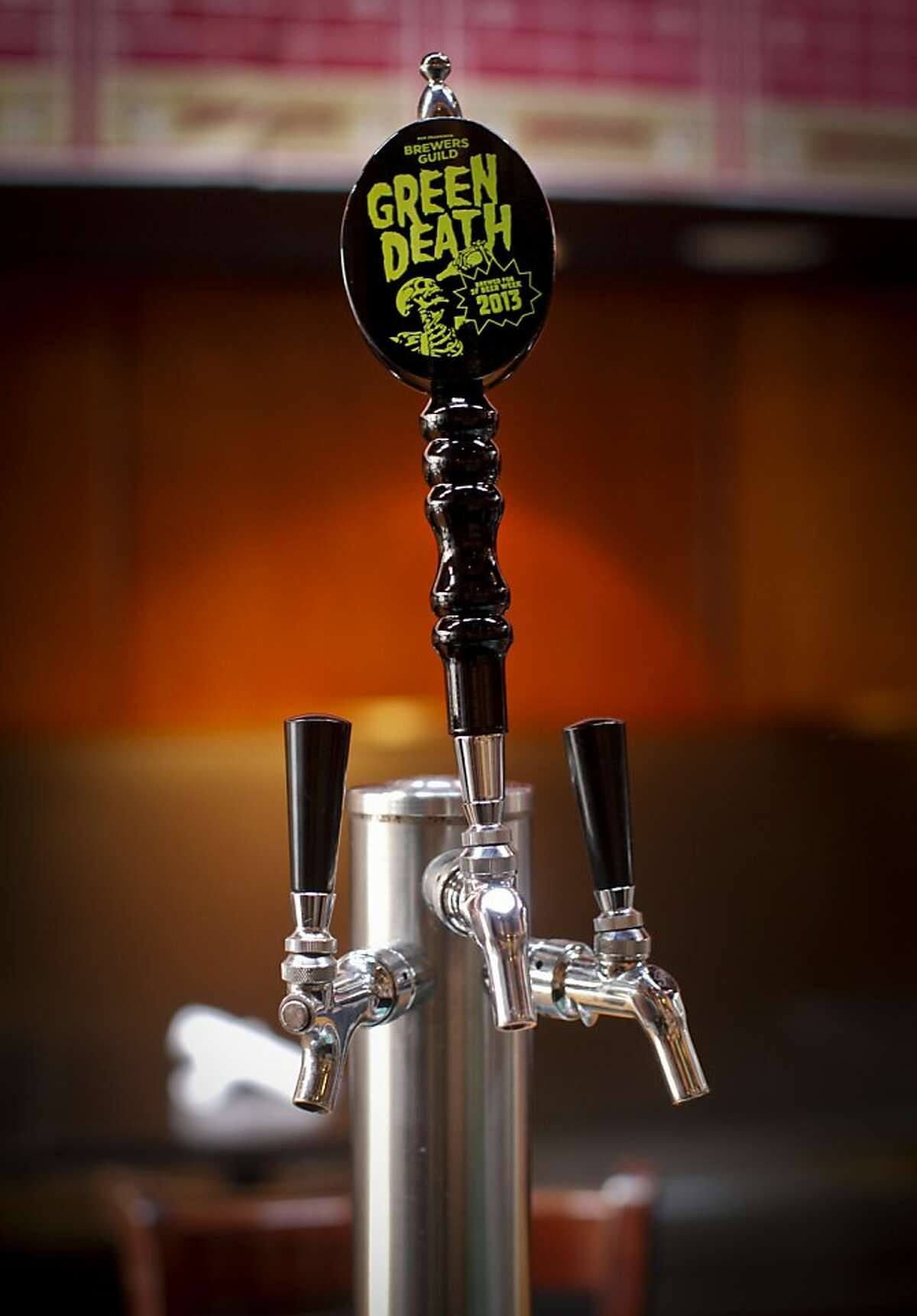 Green Death malt liquor has a special tap handle at Social Kitchen & Brewery in S.F.