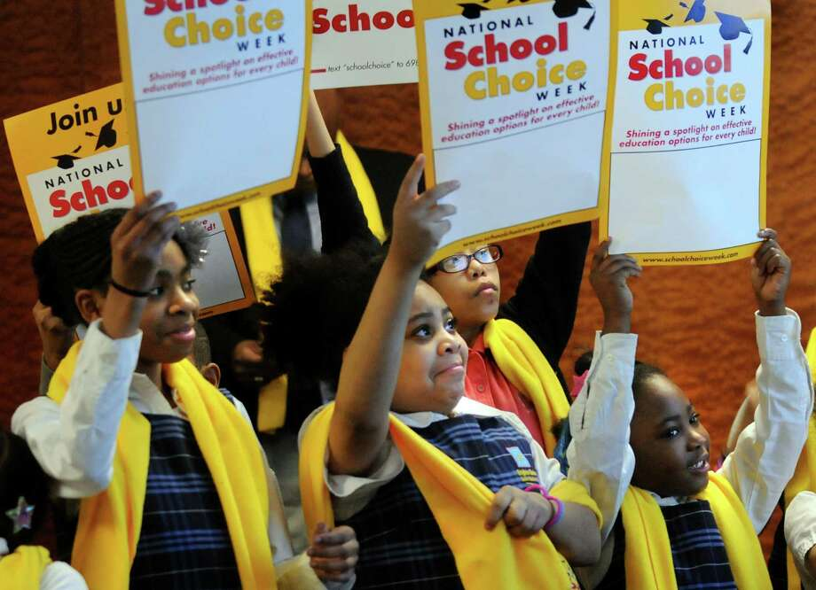 Students from Albany's Brighter Choice for Girls Charter School show their support as they attend a rally for National School Choice Week on Friday, Feb. 1, 2013, at Empire State Plaza in Albany, N.Y. (Cindy Schultz / Times Union) Photo: Cindy Schultz / 00020984A