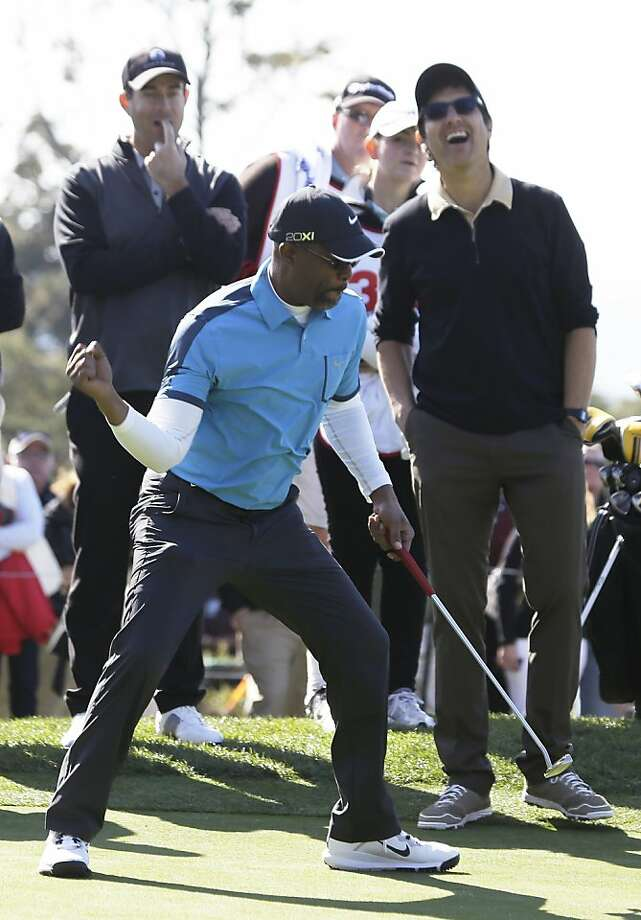 Musician Darius Rucker celebrates after sinking a birdie putt on the second green of the Pebble Beach Golf Links during the celebrity challenge event of the AT&T Pebble Beach Pro-Am golf tournament Wednesday, Feb. 6, 2013, in Pebble Beach, Calif. In the background at left is musician Clay Walker and at right is actor Ray Romano. (AP Photo/Eric Risberg) Photo: Eric Risberg, Associated Press