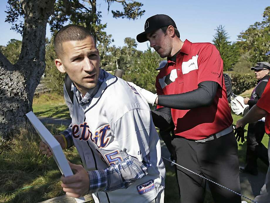 Dominic Mitchell, left, of San Bruno, Calif., gets the back of his jersey signed by Detroit Tigers pitcher Justin Verlander  near the 15th tee of the Pebble Beach Golf Links during a practice round of the AT&T Pebble Beach Pro-Am golf tournament Wednesday, Feb. 6, 2013, in Pebble Beach, Calif. (AP Photo/Eric Risberg) Photo: Eric Risberg, Associated Press