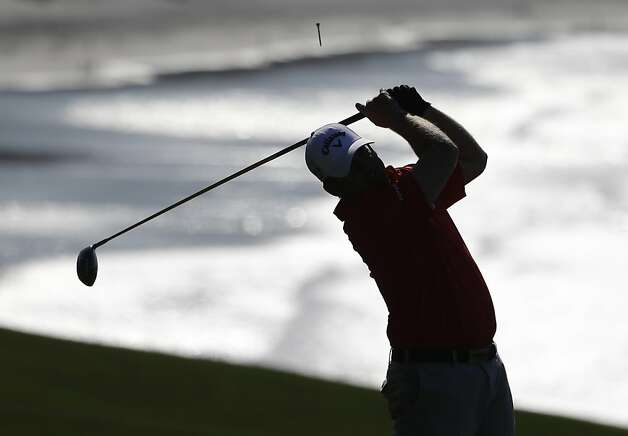 J.B. Holmes follows his drive from the 14th tee of the Pebble Beach Golf Links during a practice round of the AT&T Pebble Beach Pro-Am golf tournament  Wednesday, Feb. 6, 2013, in Pebble Beach, Calif. Photo: Eric Risberg, Associated Press