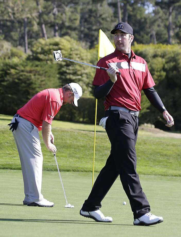 Detroit Tigers pitcher Justin Verlander, right, and J.B. Holmes, left, work on their putting on the 13th green of the Pebble Beach Golf Links during a practice round of the AT&T Pebble Beach Pro-Am golf tournament  Wednesday, Feb. 6, 2013 in Pebble Beach, Calif. (AP Photo/Eric Risberg) Photo: Eric Risberg, Associated Press
