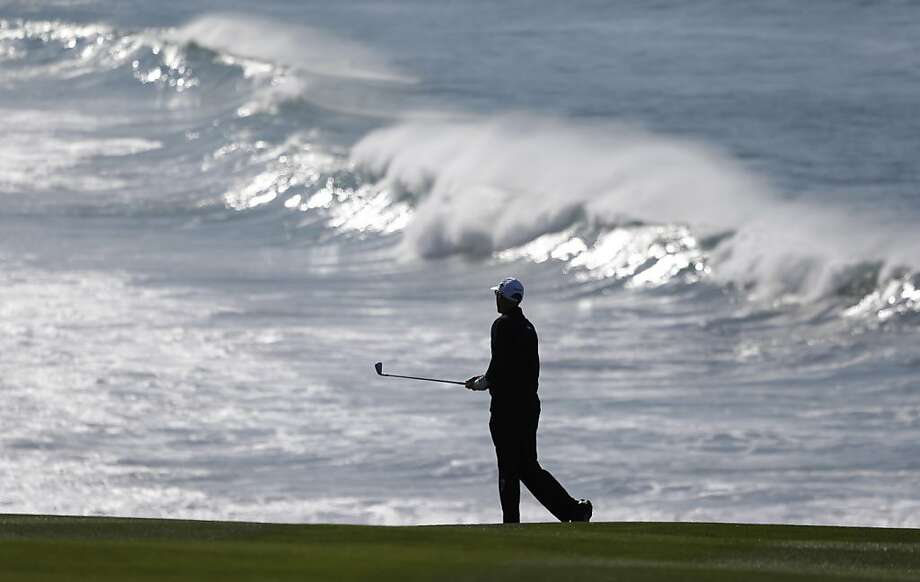 Cameron Percy of Australia follows his shot from the fairway to the ninth green of the Pebble Beach Golf Links during a practice round of the AT&T Pebble Beach Pro-Am golf tournament Wednesday, Feb. 6, 2013 in Pebble Beach, Calif. Photo: Eric Risberg, Associated Press