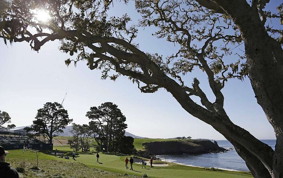 Padraig Harrington of Ireland, and his playing group make their way to the fifth green of the Pebble Beach Golf Links during a practice round of the AT&T Pebble Beach Pro-Am golf tournament  Wednesday, Feb. 6, 2013 in Pebble Beach, Calif. (AP Photo/Eric Risberg) Photo: Eric Risberg, Associated Press