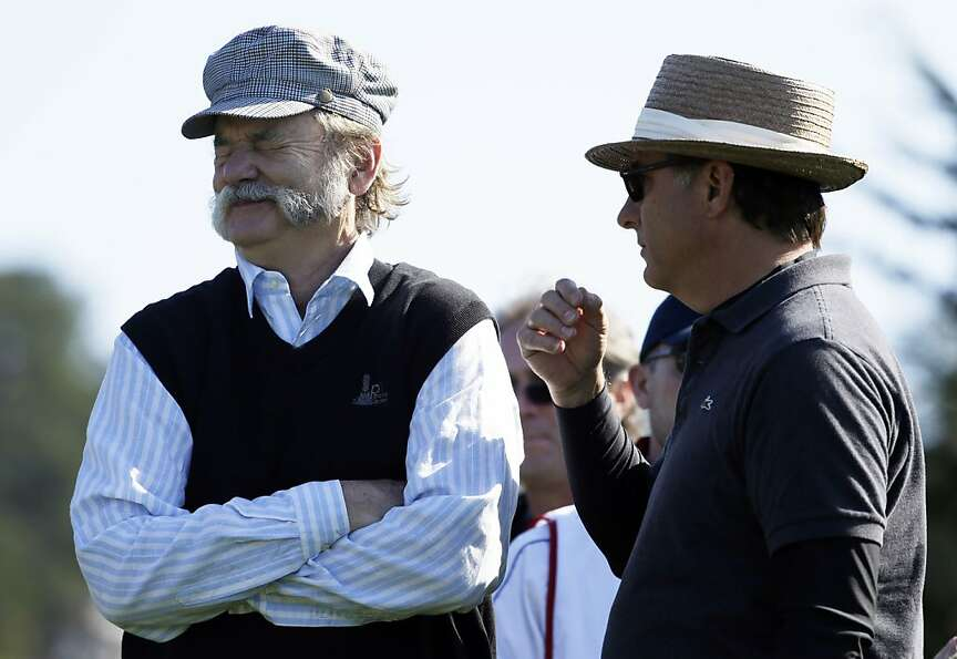 Actor Bill Murray, left, laughs with Andy Garcia, right, on the third tee of the Pebble Beach Golf L
