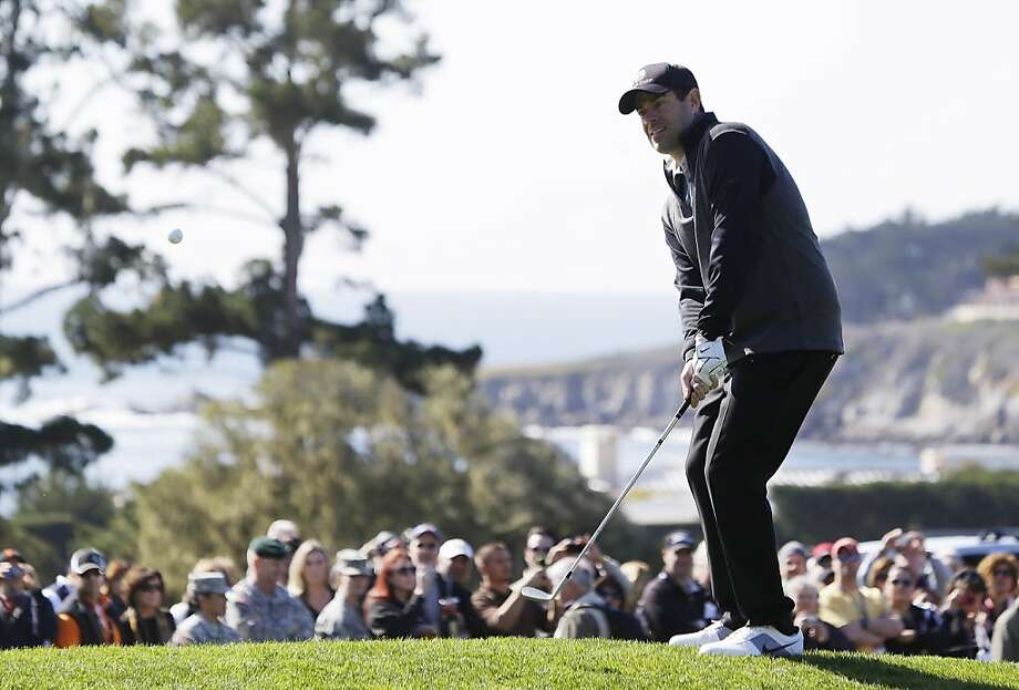 Singer Clay Walker chips the ball onto the third green of the Pebble Beach Golf Links during the celebrity challenge event of the AT&T Pebble Beach Pro-Am golf tournament Wednesday, Feb. 6, 2013 in Pebble Beach, Calif. (AP Photo/Eric Risberg) Photo: Eric Risberg, Associated Press
