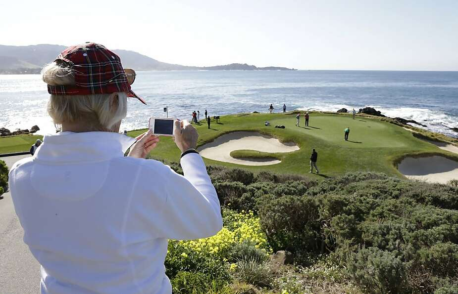 Diana Sworakowski of Capitola, Calif., takes a picture of Padraig Harrington of Ireland, and his pla