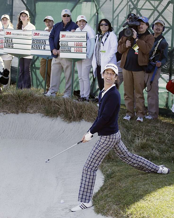 Musician Kenny G prepares to hit out of a bunker onto the 17th green of the Pebble Beach Golf Links during the celebrity challenge event of the AT&T Pebble Beach Pro-Am golf tournament on Wednesday, Feb. 6, 2013, in Pebble Beach, Calif. (AP Photo/Ben Margot) Photo: Ben Margot, Associated Press