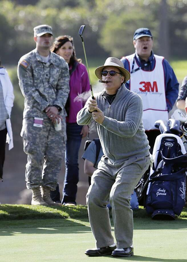 Actor Andy Garcia reacts after missing a putt on the 18th green of the Pebble Beach Golf Links during the celebrity challenge event of the AT&T Pebble Beach Pro-Am golf tournament on Wednesday, Feb. 6, 2013, in Pebble Beach, Calif. (AP Photo/Ben Margot) Photo: Ben Margot, Associated Press