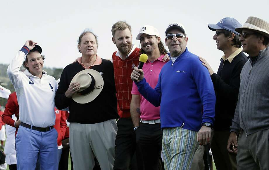 "From left to right, Clay Walker, Chris Berman, Charles Kelley, Jake Owen, Huey Lewis, Ray Romano and Andy Garcia gather on the 18th green of the Pebble Beach Golf Links to sing their version of ""America the Beautiful"" following the celebrity challenge event of the AT&T Pebble Beach Pro-Am golf tournament on Wednesday, Feb. 6, 2013, in Pebble Beach, Calif. (AP Photo/Ben Margot) Photo: Ben Margot, Associated Press"