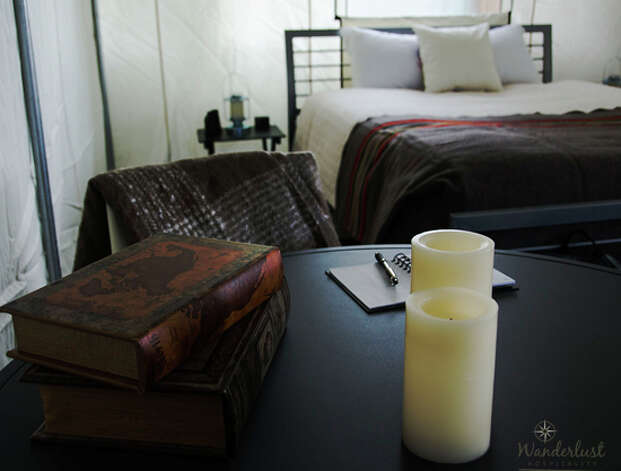 "The ""Glamping"" tent also has a cooler filled with ice, firewood, fire-starters, lanterns, flashlights, coffee mugs, water bottles, wine glasses, note pads and bath amenities. Photo: Wanderlust Hospitality"
