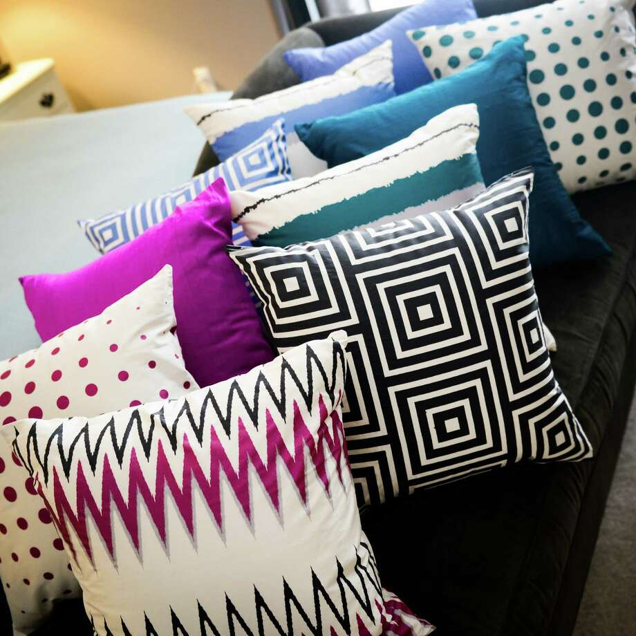 Reversible Inside&Out pillows by Houston-based Fehr Fara offer an easy way to create a new living room look. / Fehr Fara