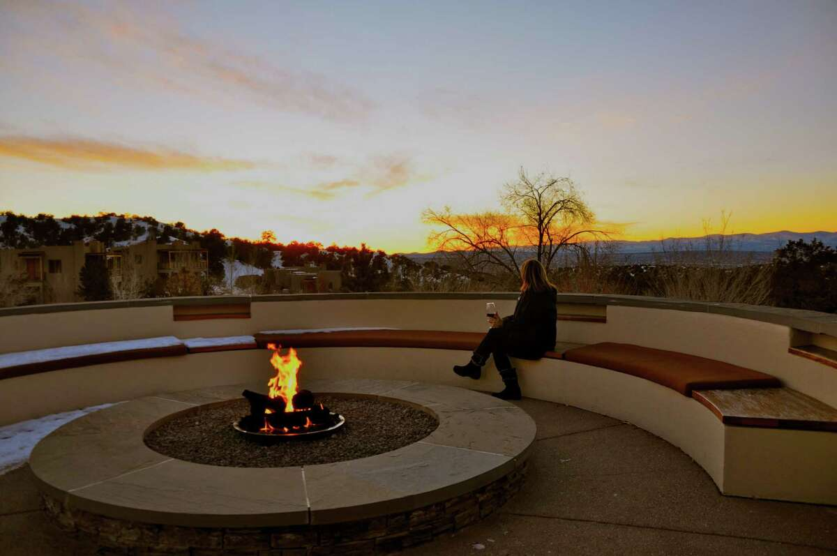 Becky Ward watches the sunset from the deck of the Four Seasons Rancho Encantado in Santa Fe, N.m.