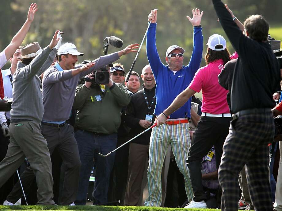 Huey Lewis in blue celebrates with Jake Owen pink top right, Josh Duhamel left and Andy Garcia wearing hat after chipping in to win the 3M Celebrity Challenge shootout  at the AT&T Pebble Beach Pro-Am golf tournament on Wednesday, Feb. 6th, 2013, in Pebble Beach, Calif. Photo: Lance Iversen, The Chronicle