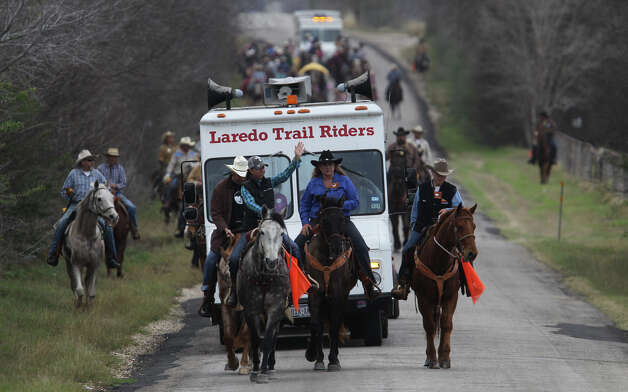Participants in the International Laredo Trail Ride head north toward San Antonio after leaving the Devine area Wednesday February 6, 2013. Trail riders are heading to San Antonio in anticipation of the San Antonio Stock Show & Rodeo which is held February 7-24. The Laredo Trail Ride arrives in San Antonio Friday February 8, 2013. Photo: JOHN DAVENPORT, San Antonio Express-News / ©San Antonio Express-News/Photo Can Be Sold to the Public