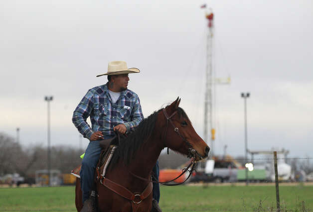 Jose Solis of Pearsall, Texas waits Wednesday February 6, 2013 for the International Laredo Trail Ride to start near Devine, Texas. The trail riders will arrive in San Antonio February 8 for the San Antonio Stock Show & Rodeo. Photo: JOHN DAVENPORT, San Antonio Express-News / ©San Antonio Express-News/Photo Can Be Sold to the Public