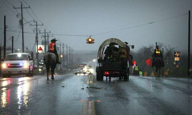 Members of the South Texas Trail Ride take to the road on US Highway 181 in Falls City, which started at 8AM today, Wednesday, Feb. 6, 2013, and reached Floresville. Photo: Bob Owen, San Antonio Express-News / © 2012 San Antonio Express-News