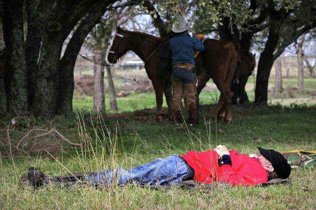 Bill Paynter of New Virginia, Iowa, takes a snooze after lunch at the VFW Post 8555 in Poth, TX.  Paynter in riding in his 14th South Texas Trail Ride which started in Falls City today, Wednesday, Feb. 6, 2013, and reached Floresville. Photo: Bob Owen, San Antonio Express-News / © 2012 San Antonio Express-News